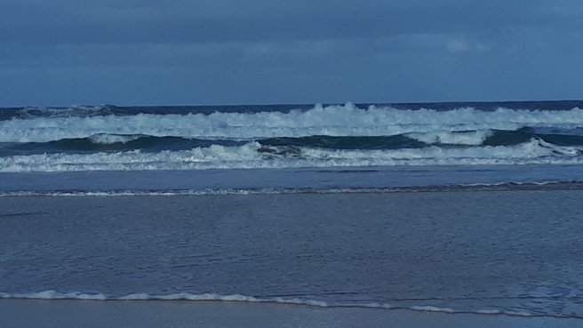 Surfing, bodyboarding, running through an ironage settlement to a